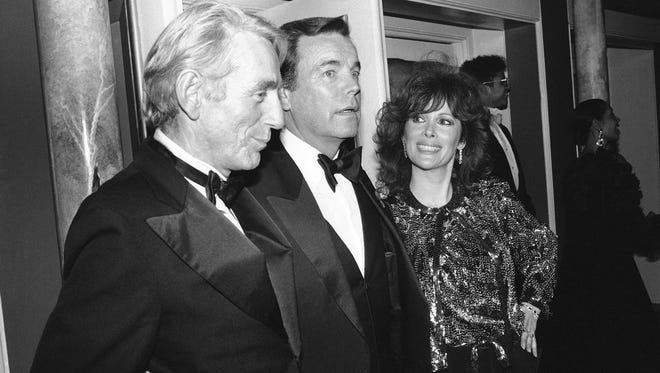 """FILE - In this Feb. 18, 1985 file photo, Jill St. John, right, with Robert Wagner, center, and Rod McKuen, left, attend a party for """"Night of 100 Stars II,"""" in New York. McKuen, the husky-voiced """"King of Kitsch"""" whose music and verse recordings won him an Oscar nomination and made him one of the best-selling poets in history, has died on Thursday, Jan. 29, 2015. He was 81. (AP Photo/Rene Perez, File)"""