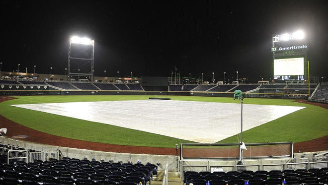 The tarp covers the infield during a weather delay in the Vanderbilt vs. Cal State Fullerton College World Series game at TD Ameritrade Park on Sunday night.