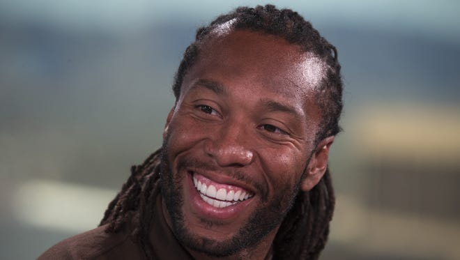 Arizona Cardinals wide receiver Larry Fitzgerald is interviewed, April 19, 2016, by Kent Somers in the azcentral studio.