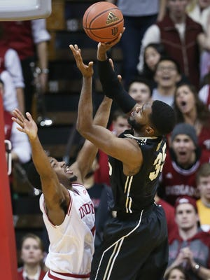 Purdue Boilermakers guard Rapheal Davis scores on a drive over Indiana Hoosiers guard Robert Johnson to put his team up 64-61 with 36 seconds left in the game. iIndiana hosted Purdue at Assembly Hall on Thursday, February 19, 2015.