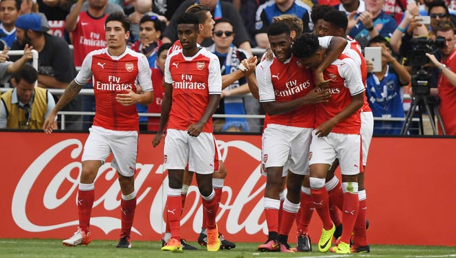 Arsenal forward Chuba Akpom (32) celebrates with teammates after scoring a goal in the second half during the 2016 MLS All-Star Game at Avaya Stadium.