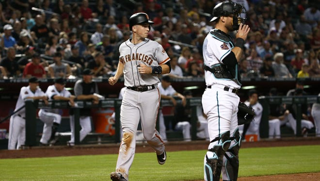 San Francisco Giants Buster Posey scores on a Austin Slater double against the Arizona Diamondbacks in the 2nd inning on June 29, 2018, at Chase Field in Phoenix, Ariz.