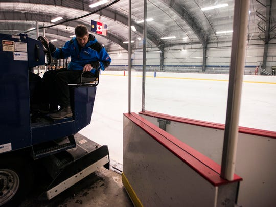 Cedric Lanphear back ups the Zamboni machine at the Ice Haus skate rink at Jay Peak Resort to prep the ice for their next customers. Lanphear says the rink has a steady flow of high school practices, tournament events and adult league games.