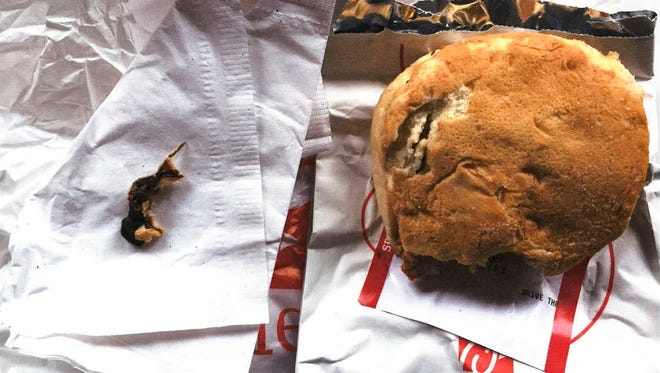 This Nov. 25, 2016, photo provided by Ellen Manfalouti, of Holland, Pa., shows the remains of a rodent, left, she alleges she found baked into the bun of a chicken sandwich, right, that a co-worker purchased for her that day at a Chick-fil-A franchise restaurant in Langhorne, Pa. Manfalouti, a suburban Philadelphia woman, sued in Bucks County Court in August 2017 over the rodent she claims was baked into the bottom bun of her chicken sandwich. (Ellen Manfalouti via AP)