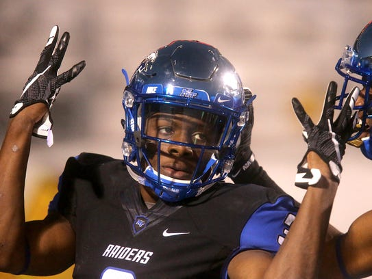MTSU receiver Richie James (3) celebrates a touchdown with Desmond Anderson (25) during a game against Florida Atlantic on Nov. 26, 2016. On this play, James broke his own record for receiving yards in a single season.