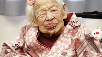 Misao Okawa poses for a photo at her nursing home in Osaka, western Japan, on March 4, 2015.