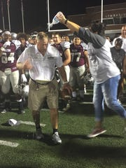 Alcoa coach Gary Rankin celebrates with a water bottle soaking after getting his 400th win, with a 52-0 victory over Pigeon Forge last season.