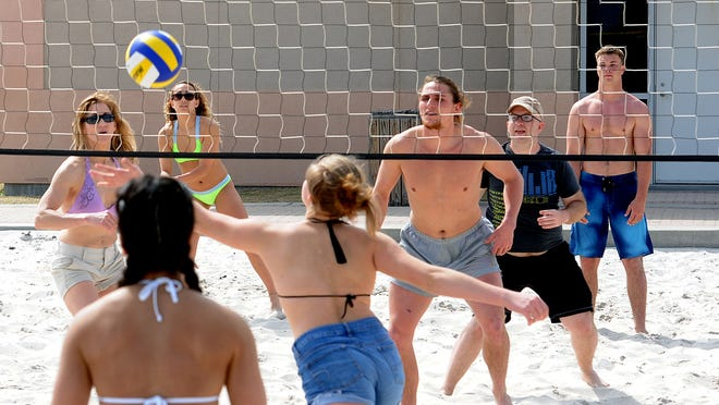 Spring breakers play volleyball Sunday at Pensacola Beach.