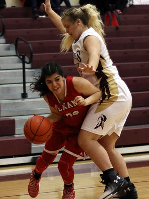 Ray's Lauren Mendoza (30) dribbles past Tuloso-Midway's Alycen Hoelscher (14) during their District 30-5A North Zone Game in Bobby Craig Gymnasium on Tuesday, January 21, 2017.