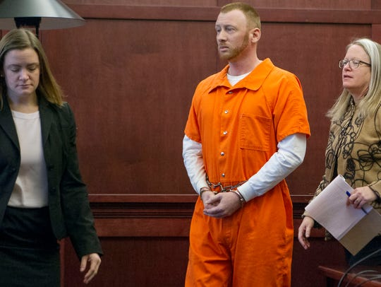 Ryan Champion, center, appears with his attorney during