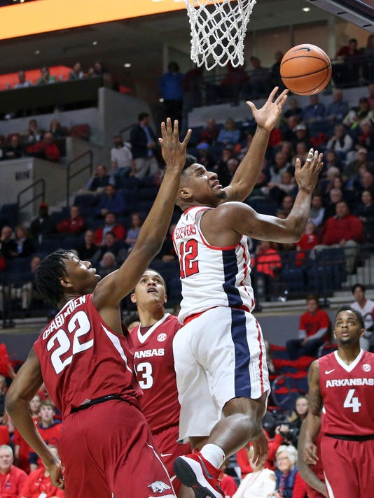 Mississippi forward Bruce Stevens (12) drives to the basket as Arkansas forward Gabe Osabuohien (22) defends during an NCAA college basketball game in Oxford, Miss., Tuesday, Feb. 13, 2018. (Petre Thomas/The Oxford Eagle via AP)