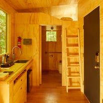 Getaway cabins are 160-square-foot tiny houses on wheels, custom designed by student architects with the newest innovations in eco-friendly technology. Each features a heater, two burner kitchen stove, queen bed, shower, electric toilet, full size sink, classic coleman cooler, kitchen utensils, pots and pans, wireless speaker, and good vibes.
