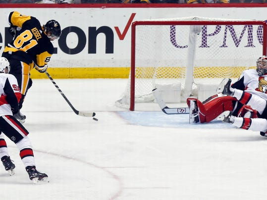 Pittsburgh Penguins' Phil Kessel (81) scores on Ottawa Senators goaltender Craig Anderson, right, during the third period of an NHL hockey game Friday, April 6, 2018, in Pittsburgh. The Penguins won 4-0. (AP Photo/Keith Srakocic)