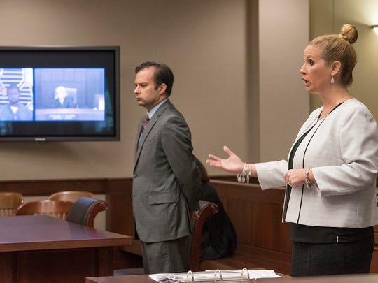 Assistant Prosecutor Danielle Bennetts argues for a ban on live streaming video. Attorney John Dakmak, for the defense, is at center.