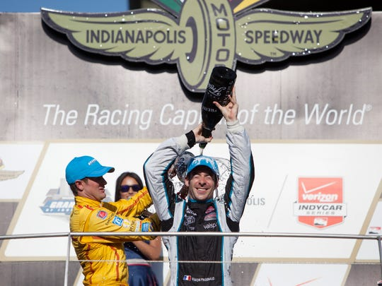 Simon Pagenaud enjoys a champagne bath after winning the inaugural Grand Prix of Indianapolis.