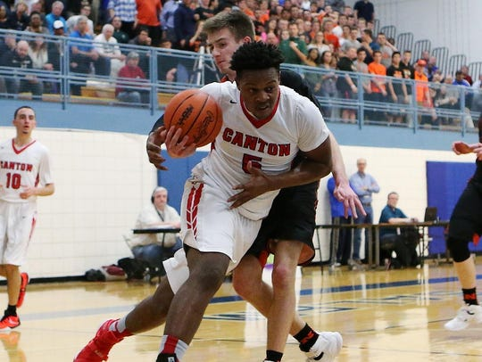 Trying to muscle his way past a Northville defender