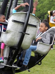 Isabel Trotman, 7, right, rides the rides during the