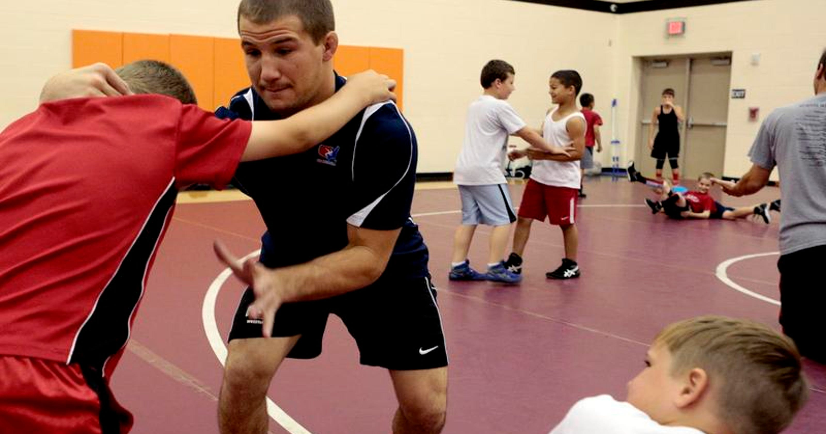 NCAA champ Stieber coaches Newark's wrestling campers