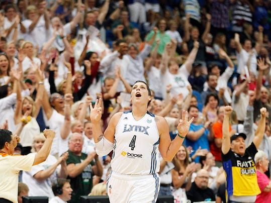 FILE - In this Sept. 4, 2013 file photo, Minnesota Lynx forward Janel McCarville (4) celebrates after hitting a three-point basket against the Los Angeles Sparks in the final second of the second quarter of a WNBA basketball game in Minneapolis. (AP Photo/Stacy Bengs, File)