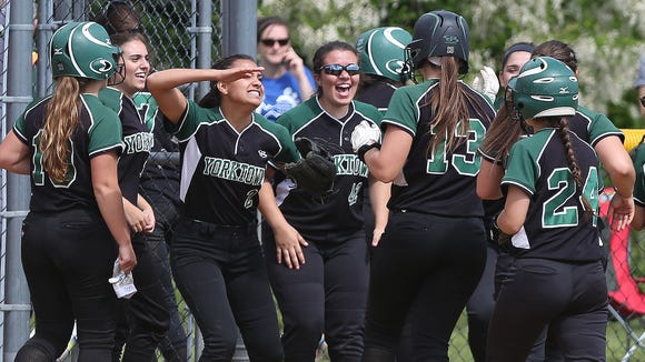 Yorktown players swarm around teammate Brianna Buck (13) after she hit a double that scored two runs against North Rockland during the Section 1 Class AA championship at North Rockland High School  May 27, 20173