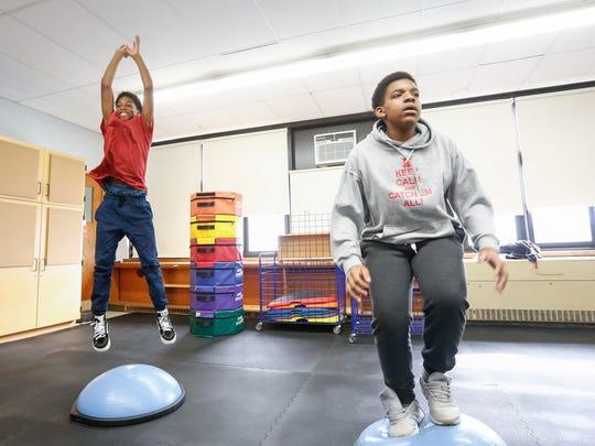 Yusef Barrett, left, and O'Neil Noel work on balance