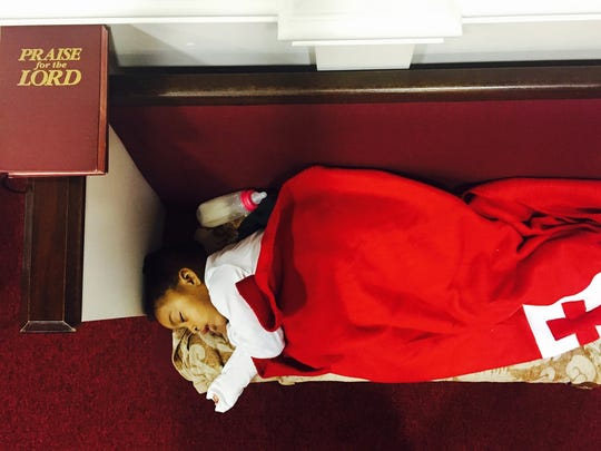 Tazarrah White, 2, sleeps at the Hartsville Pike Church