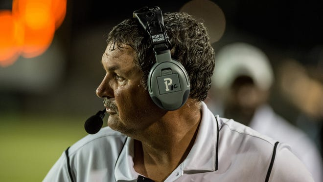 New Iberia head coach Rick Hutson paces the sidelines during an LHSAA football game against Lafayette at Lloyd G. Porter Memorial Stadium in New Iberia, La., Thursday, Sept. 24, 2015.