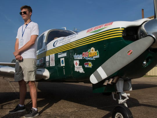 "Mason Andrews stands next to his plane while being interviewed about his solo circumnavigation flight around the world before his departure from the Monroe Regional Airport in Monroe, La. on July 22. ""It's really exciting and speaks volumes to the Louisiana Tech Aviation Program,"" Mason, an aviation student of La. Tech, will be the youngest person to perform a solo circumnavigation of the world upon his successful completion at age 18. Andrews is performing the flight to help raise money and awareness for Louisiana's MedCamps."