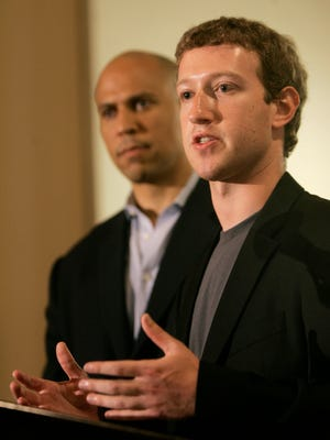 Mark Zuckerberg, right, founder and CEO of Facebook, talks about his donation of $100 million to help Newark public schools during a press conference at the Robert Treat Hotel in Newark, N.J., Saturday, Sept. 25, 2010. With Zuckerberg is Newark mayor Cory Booker and N.J. Gov. Chris Christie, not in picture. (AP Photo/Rich Schultz)