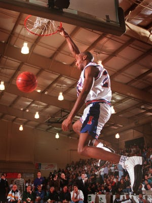Kenny Gregory of Independence High in Ohio, throws down a slam dunk Dec. 21, 1996, in the City of Palms Classic, in the second of 22 years at Bishop Verot High School. This year, the tournament has moved south, to FSW's Suncoast Credit Union Arena.