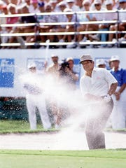 Lee Trevino plays a bunker shot at the Aetna Challenge at The Club Pelican Bay on Feb. 19, 1990.