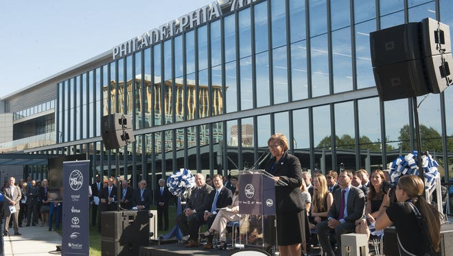 Camden Mayor Dana L. Redd speaks at a ceremony in September marking the opening of the Philadelphia 76ers' new training complex on the Camden Waterfront.