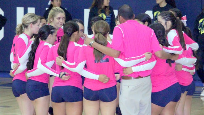 The Silver High volleyball team group up during action against rivals Cobre this past year. The Lady Colts are seeded seventh in the state tourney.