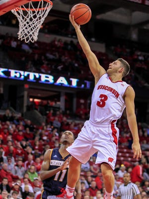 Wisconsin's Zak Showalter (3) shoots past Chattanooga's Ronrico White during the second half  Sunday.