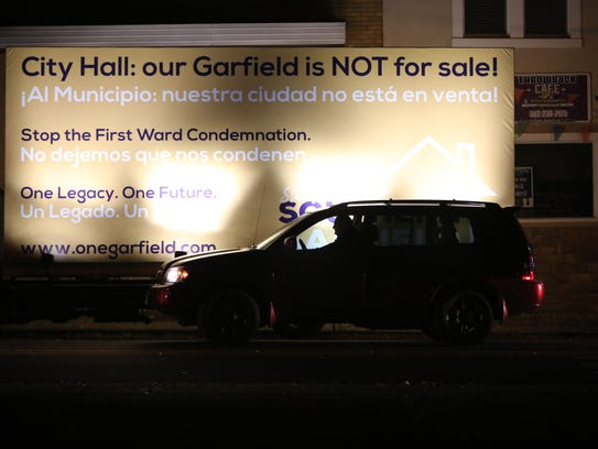 A truck parked outside Garfield City Hall on Thursday was carrying a sign against eminent domain.