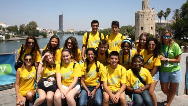 Michelle Fernandez, front center, with other AFS students at the Torre del Oro in Sevilla.