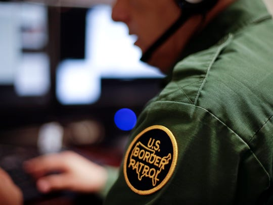 In this June 5, 2014 photo, a Border Patrol agent uses