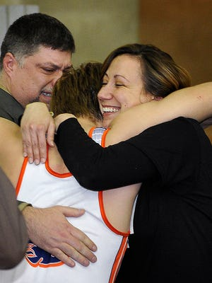 Blackman's Tyler Garrison hugs Tara Harrison Vernon, mother of Daniel Winters, who was killed in a car accident this past week. At back is Garrison's father, Scotty Garrison.