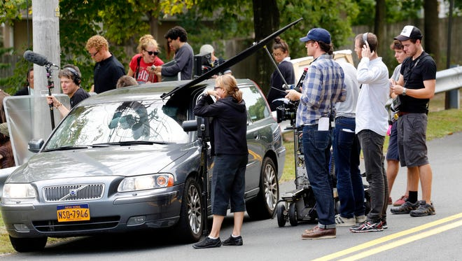 """A production crew shoots """"Louder Than Bombs,"""" a family drama starring Jesse Eisenberg, Isabelle Huppert and Gabriel Byrne, on Sept. 11 at Franklin Street Park in South Nyack. Residents have been grumbling lately about film productions taking over neighborhoods."""