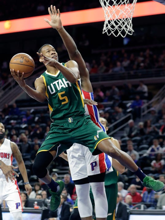 FILE - In this March 15, 2017, file photo, Utah Jazz guard Rodney Hood (5) shoots during the first half of the team's NBA basketball game against the Detroit Pistons, in Auburn Hills, Mich. Rodney Hood wasn't shy about his goal to be named the NBA's Most Improved Player at the end of the season. The Utah Jazz may need that kind of effort from the fourth-year guard to earn a second consecutive playoff berth for the first time this decade as the franchise moves on from the Gordon Hayward era. (AP Photo/Carlos Osorio, File)