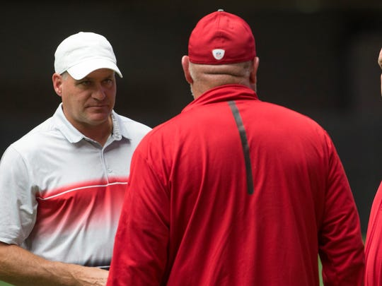 University of Arizona's head coach Rich Rodriguez talks with Cardinals' GM Steve Keim and Cardinal's head coach Bruce Arians during practice at University of Phoenix Stadium on July 29, 2016 in Glendale, Ariz.