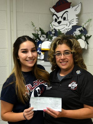 Victoria Salcido, a 2017 Deming High graduate, received a $500 check from the Deming Elks, Lodge 2750, to help with expenses at the SkillsUSA National Convention and Competition, June 19-13 in Louisville, KY. Presenting the check is Elks Lecturing Knight Yvonne Jasso-Perales. Perales is also the school's academic adviser.