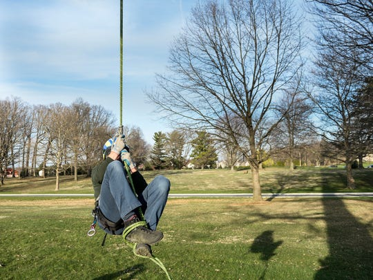 Derrick Martin, of North Cornwall Township, practices for an international tree climbing competition at the Lebanon Veterans Association Hospital on Wednesday, March 30, 2016. Martin practices on a large tree on the hospital's grounds