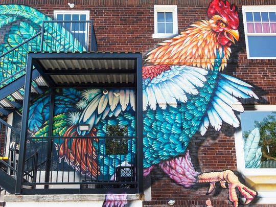 Artist Danny Gamble painted all of the murals at Casa Figueroa in Pleasant Ridge, including this rooster on the back of the building.