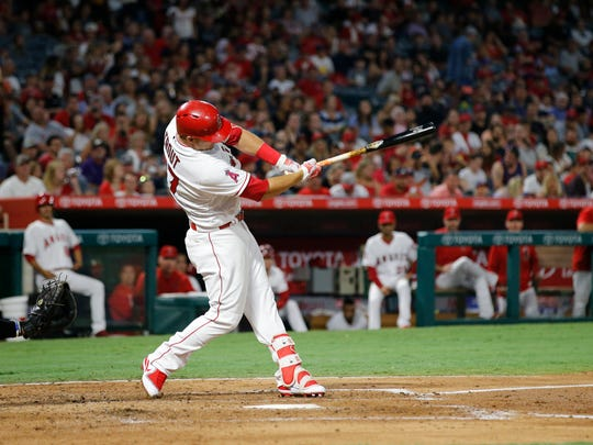 Los Angeles Angels' Mike Trout hits a double, the 1000th hit of his career, during the fourth inning of a baseball game against the Baltimore Orioles, Monday, Aug. 7, 2017, in Anaheim, Calif. (AP Photo/Jae C. Hong)