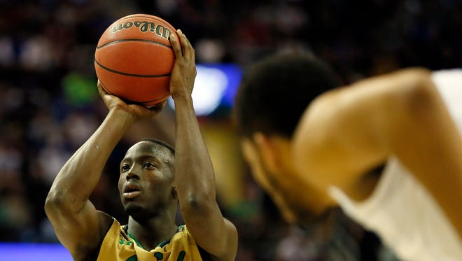 Notre Dame Fighting Irish guard Jerian Grant (22) shoots a free-throw during the second half against the Kentucky Wildcats in the finals of the midwest regional of the 2015 NCAA Tournament at Quicken Loans Arena on March 28, 2015.