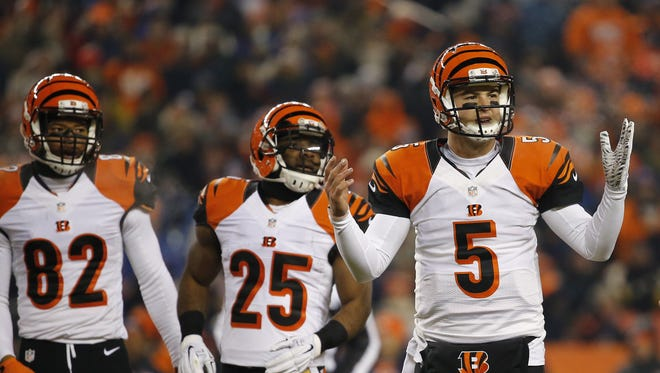 Cincinnati Bengals quarterback AJ McCarron (5) looks for a play call during the first quarter of the NFL Week 16 game between the Denver Broncos and the Cincinnati Bengals at Sports Authority Field at Mile High in Denver on Monday, Dec. 28, 2015.