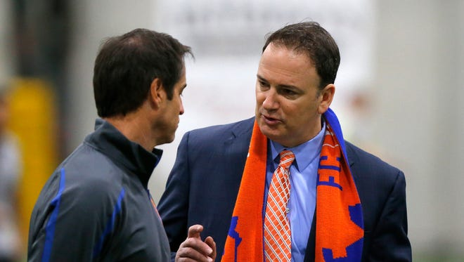 Present and general manager Jeff Berding (right) talks with head coach John Harkes after tryouts during FC Cincinnati's combine at Wall2Wall in Mason, Ohio, on Thursday, Jan. 28, 2016. FC Cincinnati's inaugural season opens on March 25 at the University of Cincinnati's Nippert Stadium.