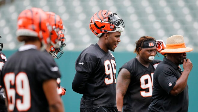 Cincinnati Bengals defensive end Carlos Dunlap (96) watches but does not participate during mini camp practice at Paul Brown Stadium in downtown Cincinnati on Tuesday, June 12, 2018.