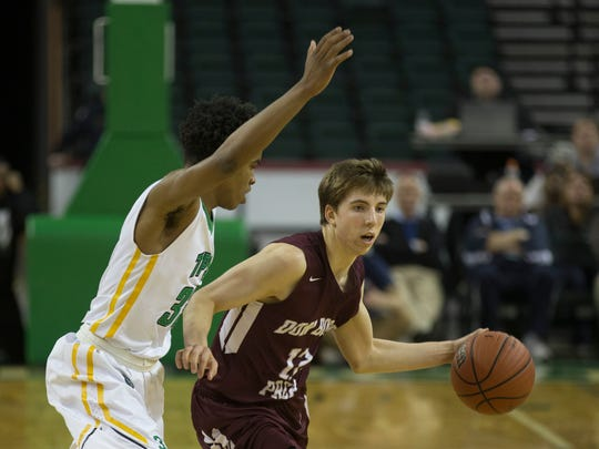 Don Bosco's Charlie Bagin has a tough job moving the ball up court as he's heavily covered by The Patrick School's Al-Amir Dawes in Monday's Tournament of Champions Final at Sun Center in Trenton.